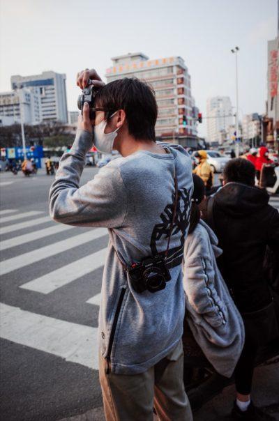 Masked photographer